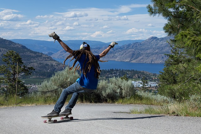 A man riding a skateboard up the side of a mountain